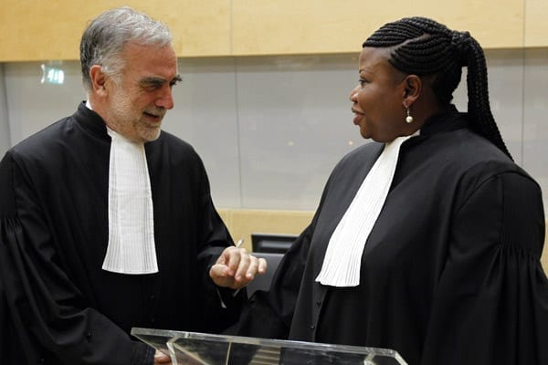 Former International Criminal Court's chief prosecutor Luis Moreno-Ocampo (left) speaks with his successor Ms Fatou Bensouda after her swearing-in ceremony as the new chief prosecutor in The Hague, on June 15, 2012. PHOTO | AFP