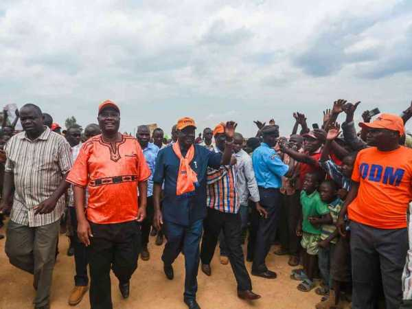 Cord leader Raila Odinga arrives in Malaba for a public rally during his tour of the western region on Thursday. Accompanying is Busia Governor Sospeter Ojamoong.