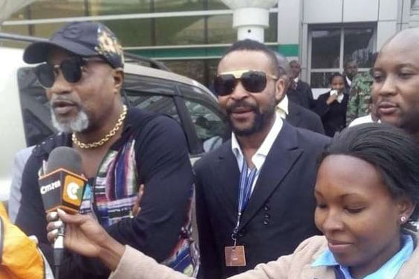 Renowned Congolese musician Koffi Olomide (left) on arrival at JKIA, Nairobi on Friday 22, 2016. The rhumba star was on July 26, 2016 arrested in his home town of Kinshasa by police. PHOTO   COURTESY