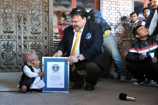 Chandra Bahadur Dangi (left), a 72-year-old Nepali is presented with a certificate by a Guinness World Records official after being declared the world's shortest man at 54.6 centimetres (21.5 inches) tall in Kathmandu on February 26, 2012. Kenyans have become shorter or stagnated in the past 100 years compared to their peers around the globe, especially those in Europe. PHOTO | AFP