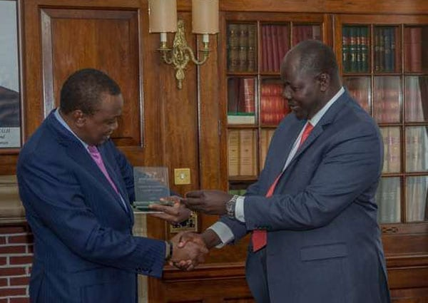President Uhuru Kenyatta receives the Global Infrastructure Leadership Award from the Director General/CEO of LAPPSET Corridor Development Authority, Silvester Kasuku, on July 28, 2016. President Kenyatta is planning to tour Kisii County. PHOTO | NATION MEDIA GROUP