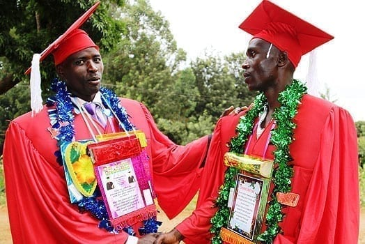 Newly graduated pastors Phineas Murithi (left) and Martin Mutugi congratulate each other after they were awarded diplomas from Dr Milendas Holiness Theological Bible College on July 31, 2016. PHOTO | CHARLES WANYORO