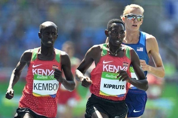 Kenya's Conseslus Kipruto and Ezekiel Kemboi, and USA's Evan Jager compete in men's 3000m steeplechase final in the Rio 2016 Olympic Games at the Olympic Stadium in Rio de Janeiro on August 17, 2016.