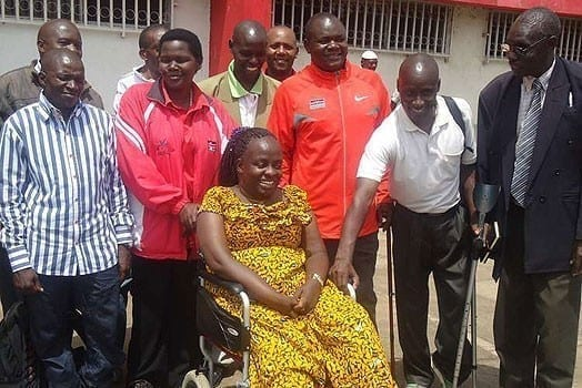 Kenya National Paralympic Committee (KNPC) President Agnes Oluoch (on a wheelchair) with other officials of the committee. PHOTO | FILE