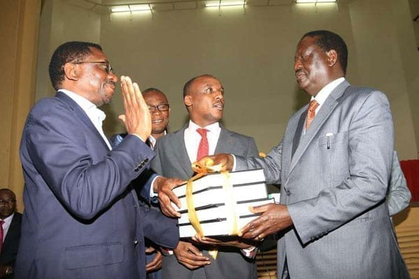 CORD leader Raila Odinga (right) receives report on electoral reforms from joint select committee members Mutula Kilonzo Junior (centre), James Orengo (left) and Eseli Simiyu at Ufungamano House, Nairobi, on August 23, 2016. PHOTO | JEFF ANGOTE | NATION MEDIA GROUP