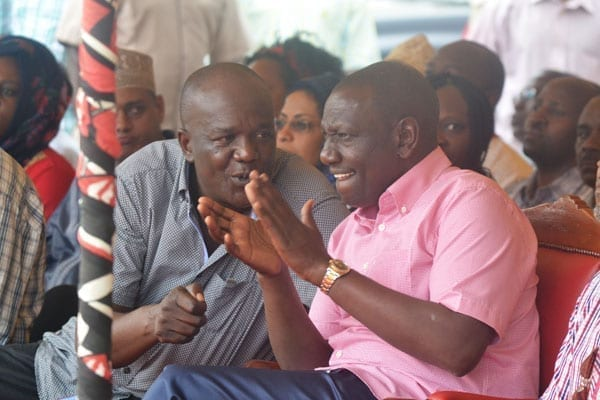 Deputy President William Ruto (right) chats with Kilifi North MP Gideon Mung'aro at Dr Kraph GroundS in Rabai for a funds drive for women's group. PHOTO   KAZUNGU SAMUEL   NATION MEDIA GROUP