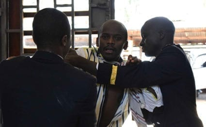 Nyeri County Assembly security guards restrain a ward representative involved in a brawl over a motion to impeach Governor Nderitu Gachagua on August 23, 2016.