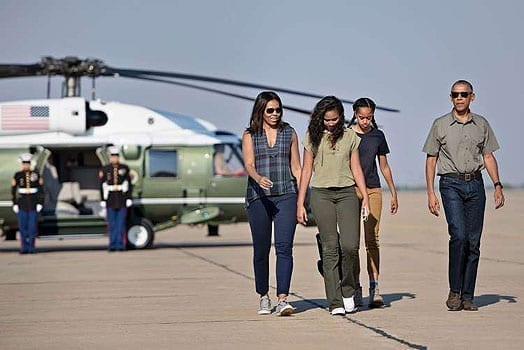 US first lady Michelle Obama with daughters Sasha and Malia and President Barack Obama walk to board Air Force One at Roswell International Air Center on June 17, 2016 in Roswell, New Mexico. AFP | PHOTO