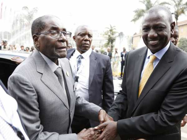 Deputy President William Ruto receives Zimbabwe President Robert Mugabe when he arrived for the TICAD conference, Nairobi. /DPPS
