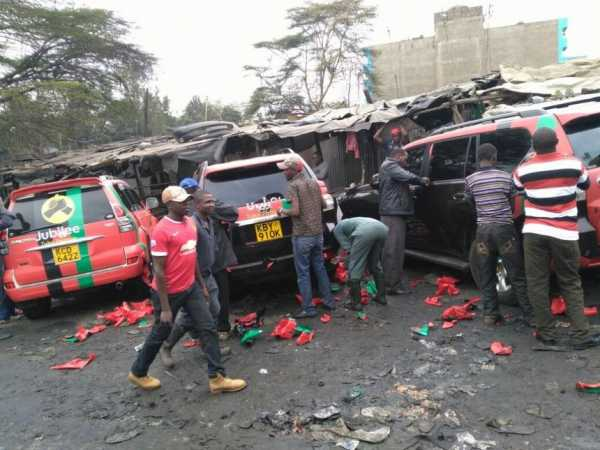 Technicians strip cars with Jubilee Party labels after the launch on Saturday, September 10. /COURTESY