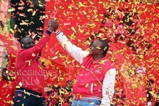 President Uhuru Kenyatta and his deputy William Ruto shows Jubilee party sign during its launch at Kasarani Stadium for the launch of Jubilee party on September 10, 2016. PHOTO DENNIS ONSONGO.