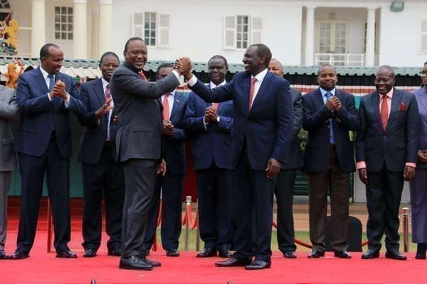 President Uhuru Kenyatta (front left) with his deputy William Ruto and officials of political parties that will merge to form the Jubilee Party at State House in Nairobi on August 9, 2016.