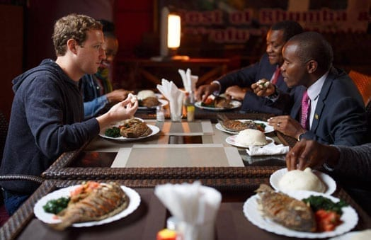 Facebook founder Mark Zuckerberg enjoys a meal of ugali and fish with ICT Cabinet Secretary, Joe Mucheru, after he arrived in Nairobi. PHOTO   COURTESY