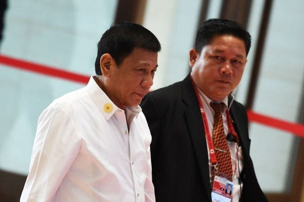 Philippine President Rodrigo Duterte (left) arrives at the convention centre to attend the 28th and 29th Association of Southeast Asian Nations (ASEAN)in Vientiane on September 6, 2016. Duterte expressed regret for a tirade against Barack Obama in which he called the US leader a