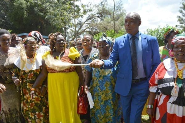 Former Mungiki leader Mr Maina Njenga joins women in a traditional jig at Karandi area in Laikipia west, Laikipia County on August 29, 2016. Mr Njenga was on September 5, 2016 blocked from an event attended by Director of Criminal Investigations Ndegwa Muhoro. PHOTO | STEVE NJUGUNA | NATION MEDIA GROUP