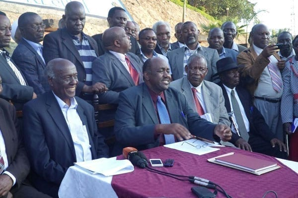 Gema chairman Bishop Lawi Imathiu (left) and Kamba Clans Governing Council chairman Boniface Kilonzo exchange copies of resolutions reached at the Masinga Dam Resort on September 16, 2016.