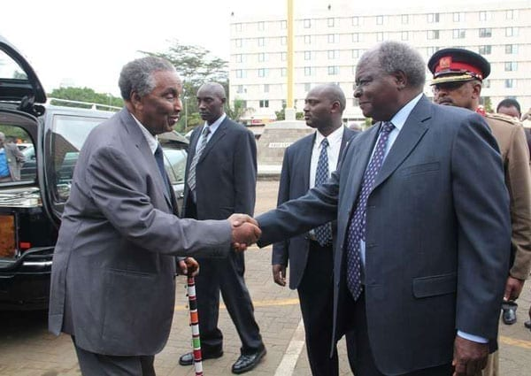 Minister of National Heritage William Ole Ntimama (left) receives President Mwai Kibaki when he arrived for the Mass of late Internal Security Minister George Saitoti at the Holy Family Basilica on June 15, 2012. He claimed friendship with every politician around, despite the well known run-ins with some, who he would rather not talk about. PHOTO | SALATON NJAU | NATION MEDIA GROUP