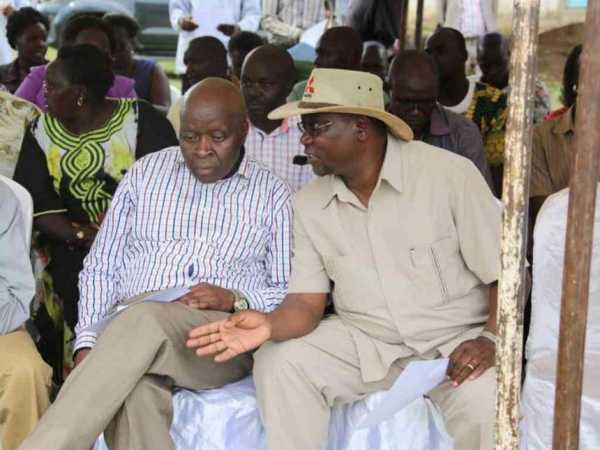 John Marirmoi, former Marakwet East MP and assistant minister in the Moi government, chats with former IG David Kimaiyo at a rally in Tot, September 30, 2016.  /STEPHEN RUTTO