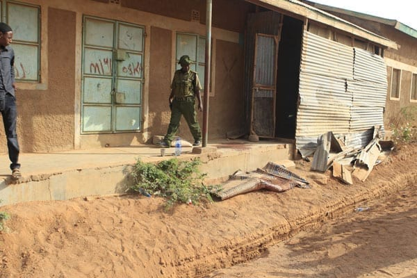 A policeman at the scene where a man was shot dead as the police engaged Al-Shabaab militants in Mandera Town in a fight on October 18, 2016. The militants dressed in hijabs were on unknown mission when they encountered police attached to Mandera Governor Ali Roba. PHOTO | MANASE OTSIALO | NATION MEDIA GROUP.