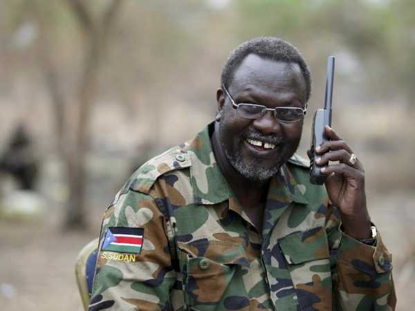A file photo of South Sudan's rebel leader Riek Machar talks on the phone in his field office in a rebel-controlled territory in Jonglei State, South Sudan, February 1, 2014. /REUTERS