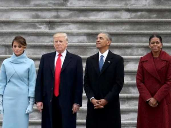 President Donald Trump and former president Barack Obama exchange words at the U.S. Capitol with First Lady Melania Trump and Michelle Obama in Washington, DC., U.S., January 20, 2017. In today's inauguration ceremony Donald J. Trump becomes the 45th president of the United States. REUTERS
