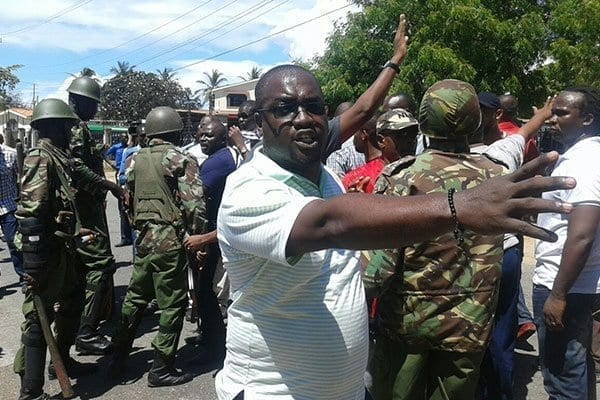 Mr Joho's supporters protest after being