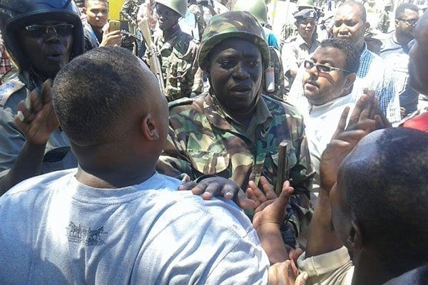 Mr Joho's supporters confront police after