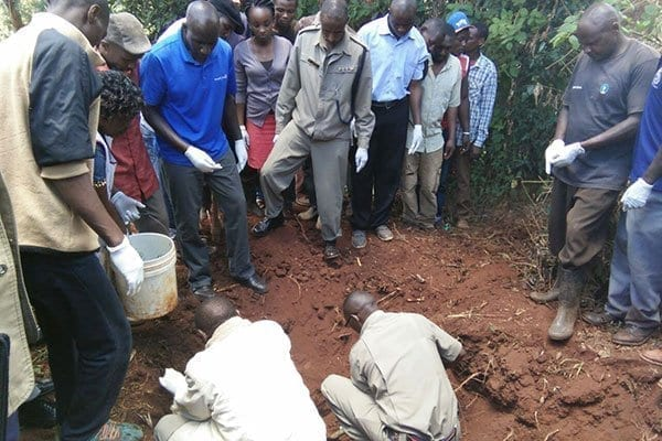 Police dig up the body of Mrs Grace Wangari