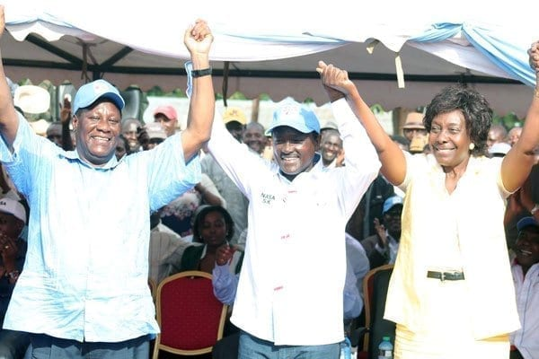 Former Lands Cabinet Secretary Charity Ngilu, Wiper Leader Kalonzo Musyoka and Kitui Governor Julius Malombe hold hands on March 28, 2017 during an event in Emali, Makueni County. PHOTO | DENNIS ONSONGO | NATION MEDIA GROUP