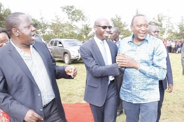 President Uhuru Kenyatta shares a light moment with Nairobi governor's director of communications Walter Mong'are and Education cabinet secretary Fred Matiang'i on March 22, 2017 Nyamira County. PHOTO | COURTESY