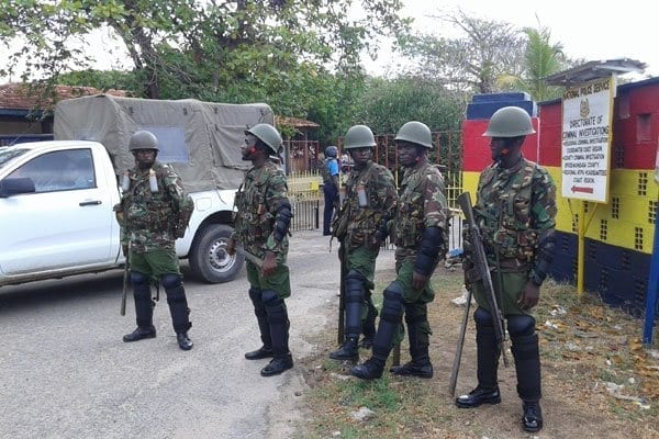 Anti-riot police officers outside the Coast