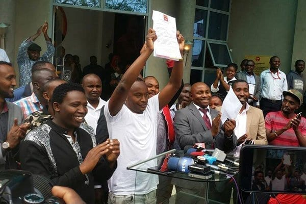 Popular musician Charles Njagua Kanyi, aka Jaguar, displays a copy of a nomination ruling in his favour on May 3, 2017 after the Jubilee Party Appeals Tribunal declared him the winner of Starehe constituency nominations. He had appealed an earlier declaration that showed MP Maina Kamanda had won the primaries. PHOTO | AGGREY MUTAMBO | NATION MEDIA GROUP