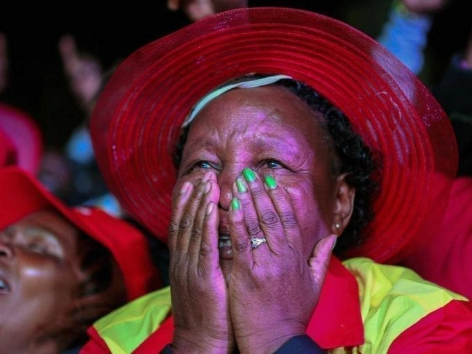 A supporter of incumbent President Uhuru Kenyatta reacts after he was announced winner of the presidential election in Nairobi, Kenya August 11, 2017. /REUTERS