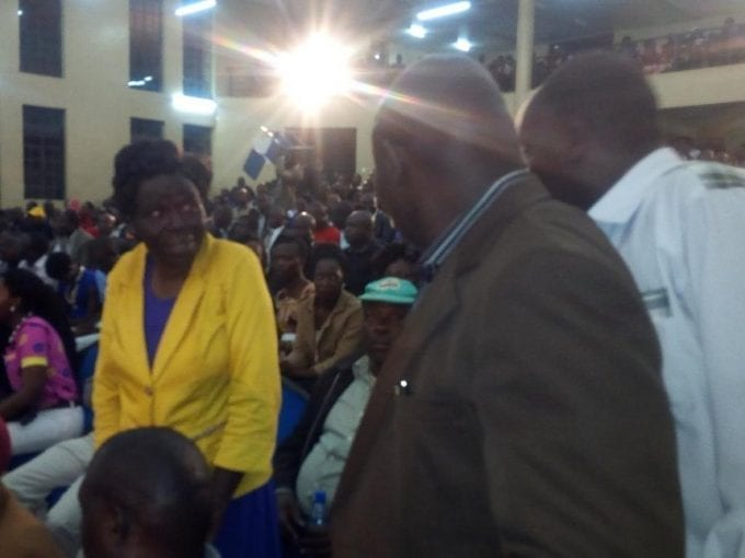 Hellen Nangekhe confronts security guards asked to whisk her out of Kibabii Univerity main hall on Friday, August 18, 2017. /JOHN NALIANYA