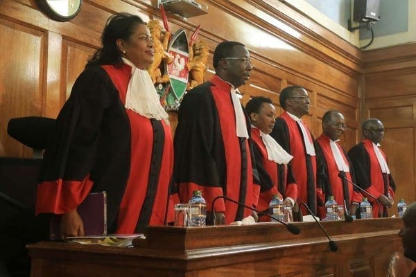 Supreme Court justices line up on Tuesday. Mr Raila Odinga, declared loser of the August 8 election by the electoral commission, is challenging the re-election of President Uhuru Kenyatta. A ruling is expected to be read in Nairobi on Friday. PHOTO | JEFF ANGOTE | NATION MEDIA GROUP