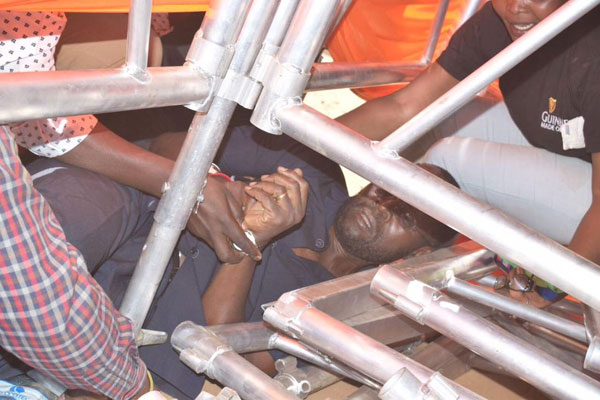 Kisumu Senator Anyang Nyong'o is shielded from a rowdy group when chaos erupted at an ODM rally in Migori on April 3, 2017. PHOTO | BARACK ODUOR | NATION MEDIA GROUP