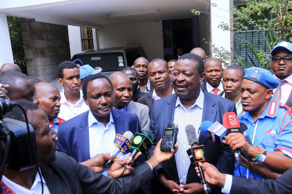 In the wake of a raging storm over the opposition's presidential flagbearer, Nasa leaders Kalonzo Musyoka (left) and Musalia Mudavadi address the media after meeting at Wiper party headquarters on April 12, 2017. PHOTO | JEFF ANGOTE | NATION MEDIA GROUP
