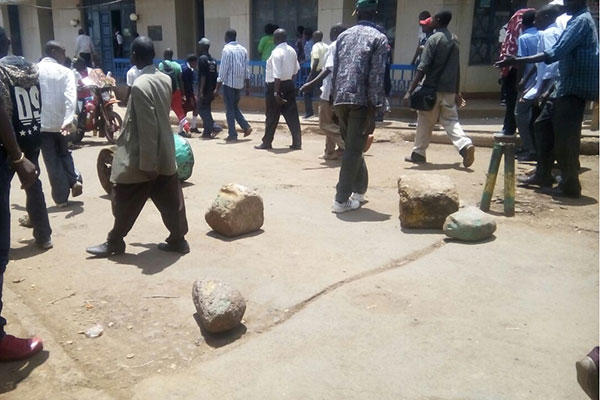 Youths block the entrance to Meru town main