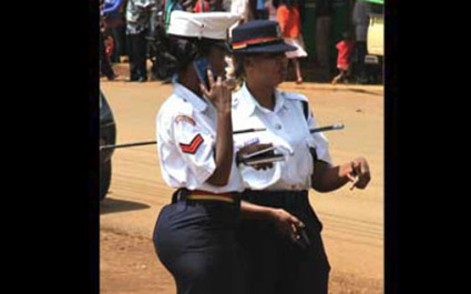 Corporal Linda Okello (left) has been at the centre of public debate after this picture of her in a tight skirt at a KCB rally ran in a newspaper. FILE