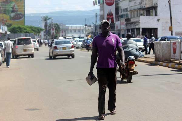 Amunga walks in the streets of Kisumu. PHOTO |