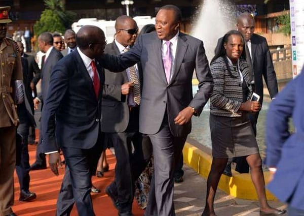 President Uhuru Kenyatta converse with Unctad Secretary-General Mukhisa Kitui during the closing ceremony of the event at KICC in Nairobi on July 22, 2016. Kenya supplied transport services worth $170.5 million (Sh17 billion), making it the fourth largest supplier behind Denmark, Russia and the US, but followed by Ethiopia in the region. PHOTO   SALATON NJAU   NATION MEDIA GROUP