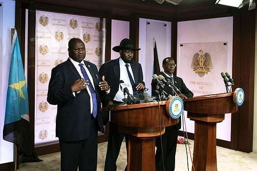 First Vice President Riek Machar (L) delivers a speech to journalists next to South Sudan President Salva Kiir (C) and Vice President James Wani Igga (R) prior to the shooting outside the presidential palace in Juba on July 8, 2016. PHOTO | AFP