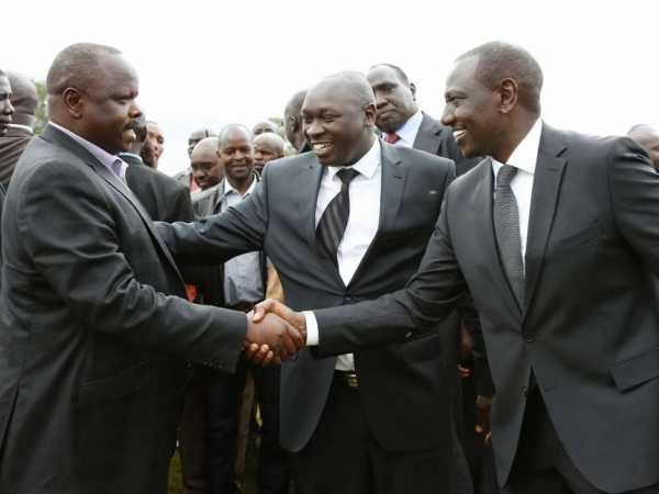 Bomet Governor Isaac Rutto and Presidential Adviser Joshua Kuttuny welcome Deputy President William Ruto to the Requiem Mass for the father of former Konoin MP Julius Kones on May 10, 2016. PHOTO/CHARLES KIMANI/DPPS