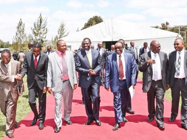 Deputy President William Ruto accompanied with CS Mwangi Kiunjuri (2nd left, red tie) and some of the governors during meeting of IBEC at his Karen office last week. PHOTOS / DANIEL