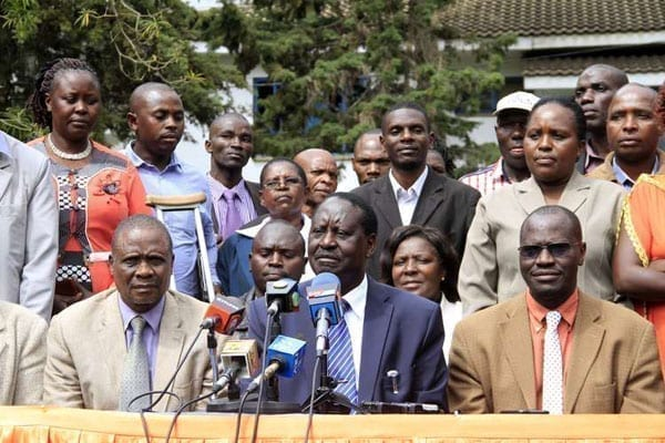Cord leader Raila Odinga with members of the Kisii community living in Nairobi at a press conference at Orange House in the city on August 9, 2016. PHOTO | DIANA NGILA | NATION MEDIA GROUP