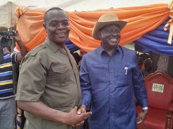 Funyula MP Paul Otuoma with Cord leader Raila Odinga on Saturday. /COURTESY