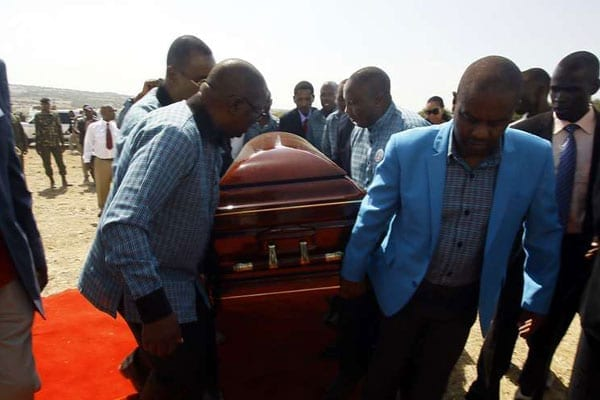 Pall-bearers, including family members carry the casket bearing the remains of the late Cabinet minister William ole Ntimama during his burial at his Motonyi Village home in Narok on September 14, 2016.
