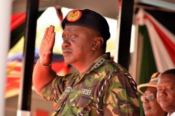 President Uhuru Kenyatta salutes the General Service Unit (GSU) officers