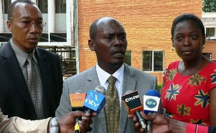 Kiambu Governor William Kabogo (centre) and the county's Woman Representative Anna Nyokabi Gatheca.