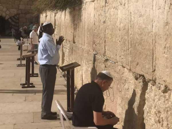 NASA flag bearer Raila Odinga prays at the Wailing Wall in Israel. /COURTESY